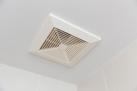 Air ventilation moisture duct in bathroom pipe hole at ceiling.