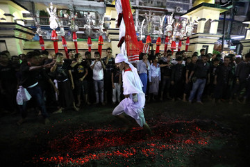 A Shi'ite Muslim walks on hot coals at a ceremony during the Ashura festival at a mosque in central Yangon