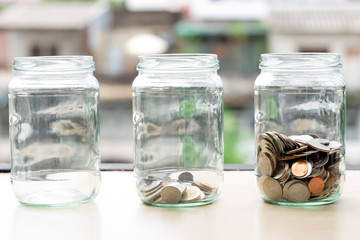 saving money coin accumulated in glass jar