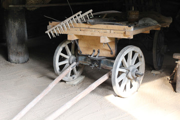 Ancient cart with retro agricultural tools