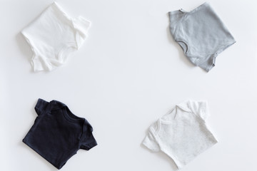 Top view and flat lay of Neutral set of baby boy clothing on white background