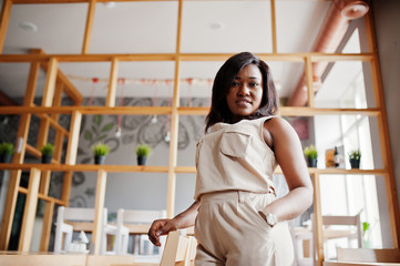 Stylish african american girl posed at modern cafe.