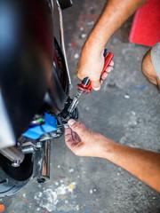 Motorcycle Mechanic at Work