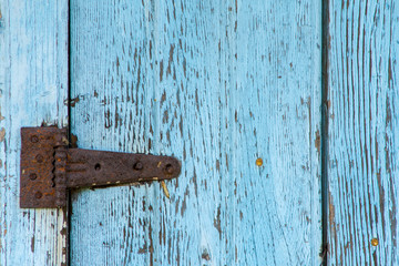 details of an old barn entrance gnawed by passing time