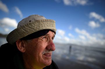 Sea angler Con O'Sullivan checks the sun during the Diawa Irish Pairs sea angling event in windy conditions on the Dingle Peninsula of Inch beach in Inch