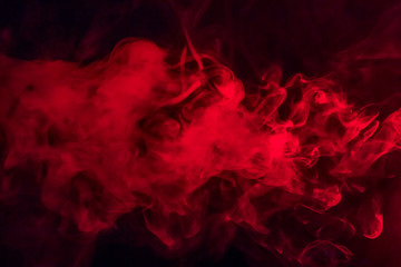 Keuken foto achterwand Texturen Colorful smoke on a black background of red and white colors. The concept of smoking. Beautiful textural background