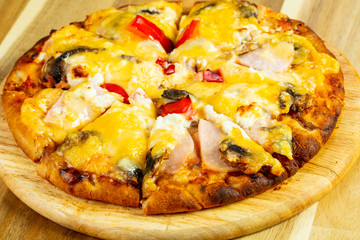 Pizza with mushrooms and ham
