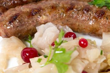 Grilled sausages with sauerkraut.