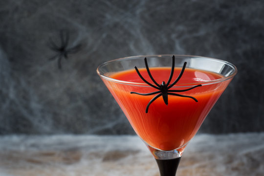 Bloody Mary cocktail, spider web background for Halloween, selective focus