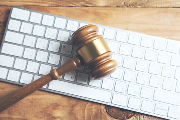 Gavel on keyboard, legal law concept