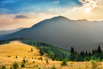Landscape with beautiful sunset in the mountains