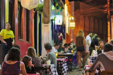 Old street restaurants with crowd waiting for dinner. Lençois city, Brazil