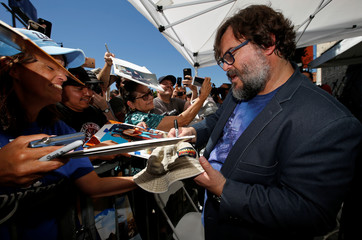 Actor Jack Black signs autographs at the unveiling of his star on the Hollywood Walk of Fame in Los Angeles