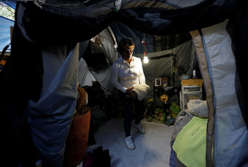 Maria Guadalupe Padilla is pictured inside her tent in the Tlalpan neighbourhood, near the site where her building was damaged by the devastating earthquake, that took place in Mexico City last year