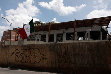 A Mexico's flag waves in the site where the Enrique Rebsamen school was damaged by the devastating earthquake, that took place in Mexico City last year in Mexico City,