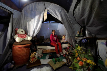 Maria Guadalupe Padilla rests in her tent in the Tlalpan neighbourhood, near the site where her building was damaged by the devastating earthquake, that took place in Mexico City last year
