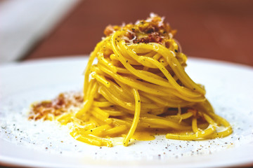 Spaghetti alla carbonara with guanciale, eggs and pecorino cheese