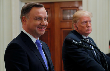 Poland's President Duda smiles during joint news conference with U.S. President Trump at the White House in Washington