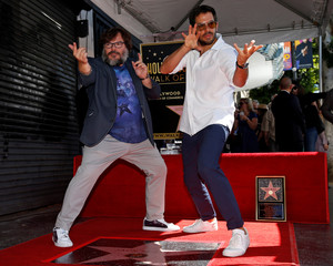 Actor Jack Black poses with director Eli Roth at the unveiling of his star on the Hollywood Walk of Fame in Los Angeles