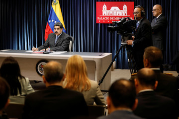 Venezuela's President Nicolas Maduro attends a news conference at Miraflores Palace in Caracas