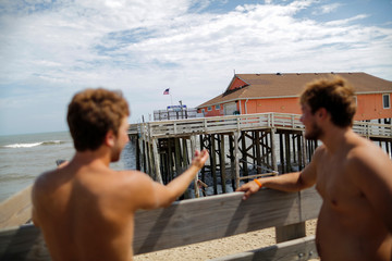 People take a look at the Rodanthe pier after being partially damaged after the pass of Hurricane Florence, now downgraded to a tropical depression in Rodanthe, North Carolina