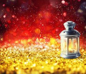 Shiny lantern on a Christmas sparkle background