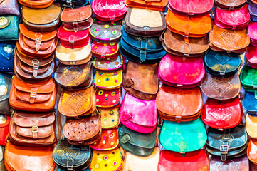 Colorful handicrafted handbags in the souk of Marrakech - Morocco