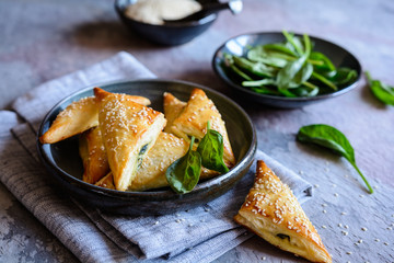 Spanakopita triangles stuffed with spinach and Feta cheese