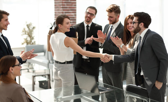 young business woman meets colleagues in the office