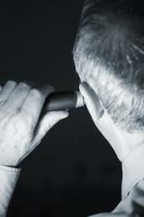 Man cutting ear hair