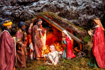 Christmas nativity scene with Holy Family in the hut and the three wise men.