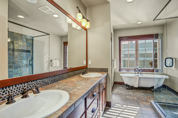 Master bathroom with double sink vanity cabinet.