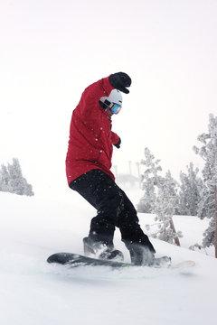 Man snowboarding, Mammoth, California, United States
