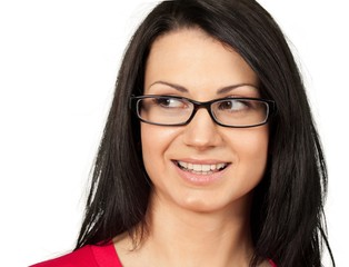 Friendly Young Woman with Glasses Smiling - Isolated