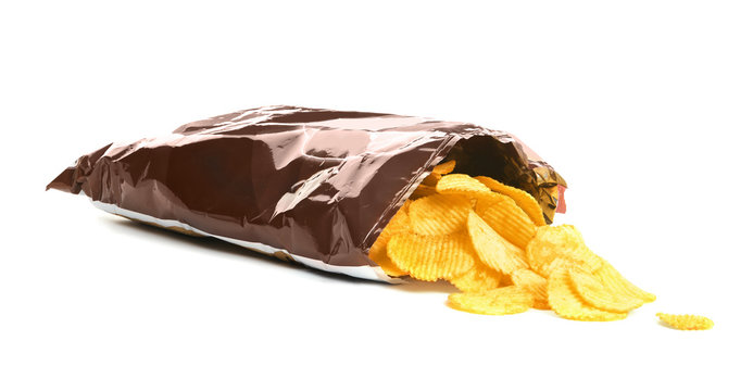 Bag with crispy potato chips on white background