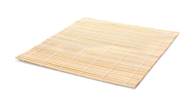 Sushi mat made of bamboo on white background