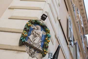 Madonna sculpture on a street corner in Rome, Italy
