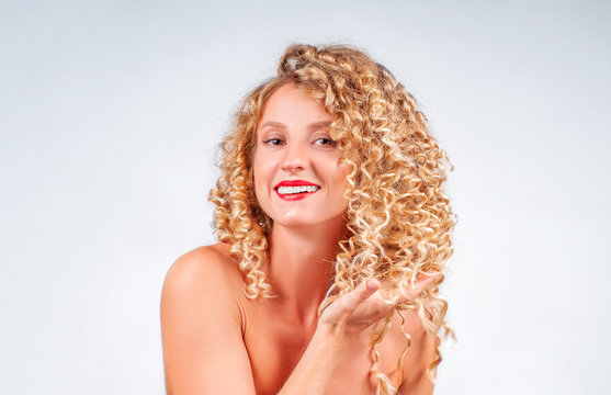 Beautiful woman with curly blonde hair.