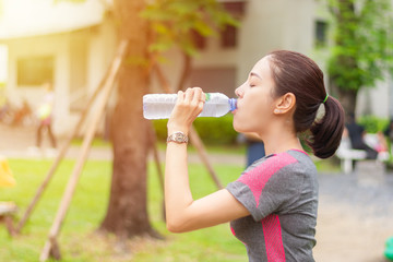 asia sport girl drinking water