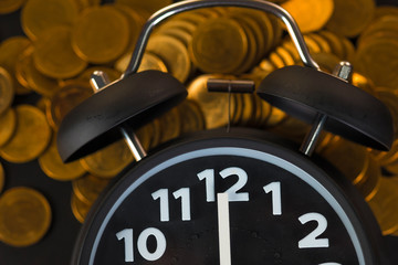 Alarm clock and coins stacks on working table, time for savings money concept, banking and business concept