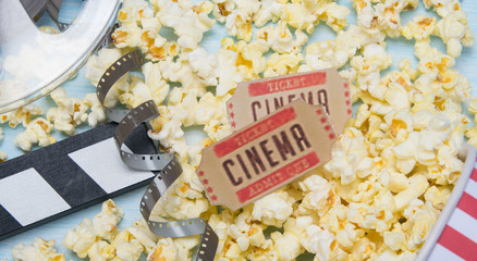 two tickets to the movies, against the background of popcorn and a film