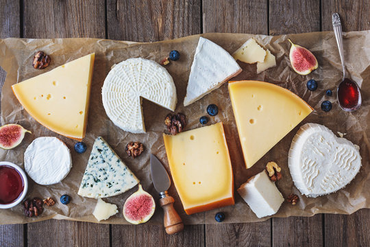 various types of cheese on rustic table top view