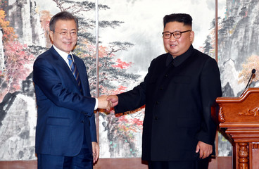 South Korean President Moon Jae-in shakes hands with North Korean leader Kim Jong Un after a joint press conference in Pyongyang