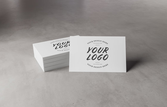 White business card stack on concrete desk 3D rendering
