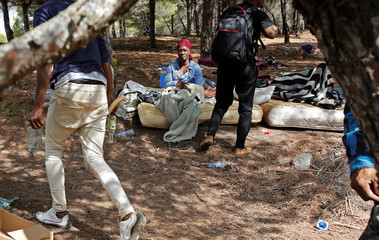 African migrants are seen in a makeshift camp in the Moroccan mountains near the city of Tangier