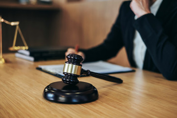 Judge gavel with Justice lawyers, Businesswoman in suit or lawyer working on a documents. Legal law, advice and justice concept