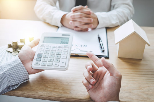 Business Signing and analyzing a contract buy - sell house, insurance agent analyzing cost about home investment loan Real Estate, Concept mortgage loan approval