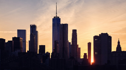 Manhattan skyline silhouette at sunset, color toned picture, USA.