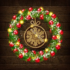 Christmas wreath with gold snowflake