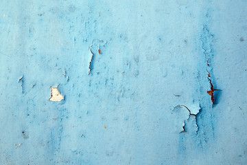 Old metal surface with cracked blue paint. texture, background